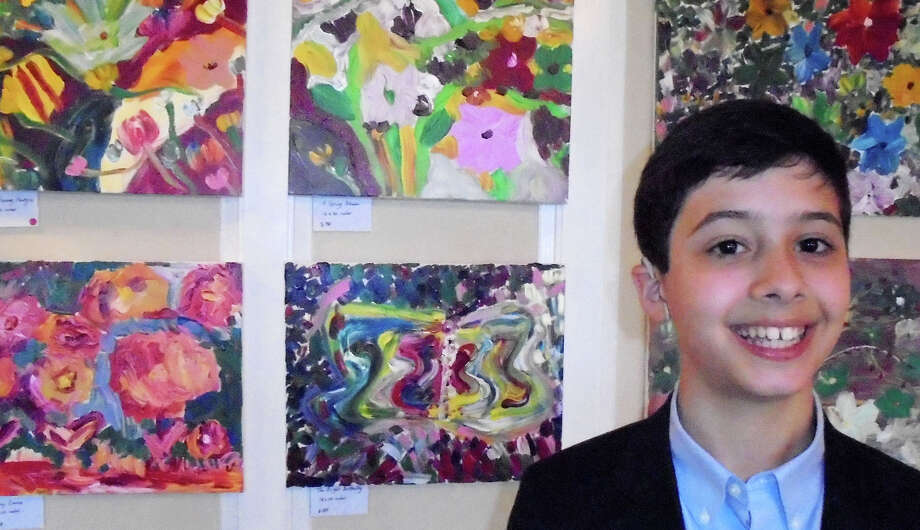Alex Mussomeli, 11, of Westport, in front of his acrylic paintings during his first solo art show at the Fairfield County Hunt Club, which was a fundraiser for the Hearing Health Foundation. Photo: Westport News / Meg Barone / Westport News