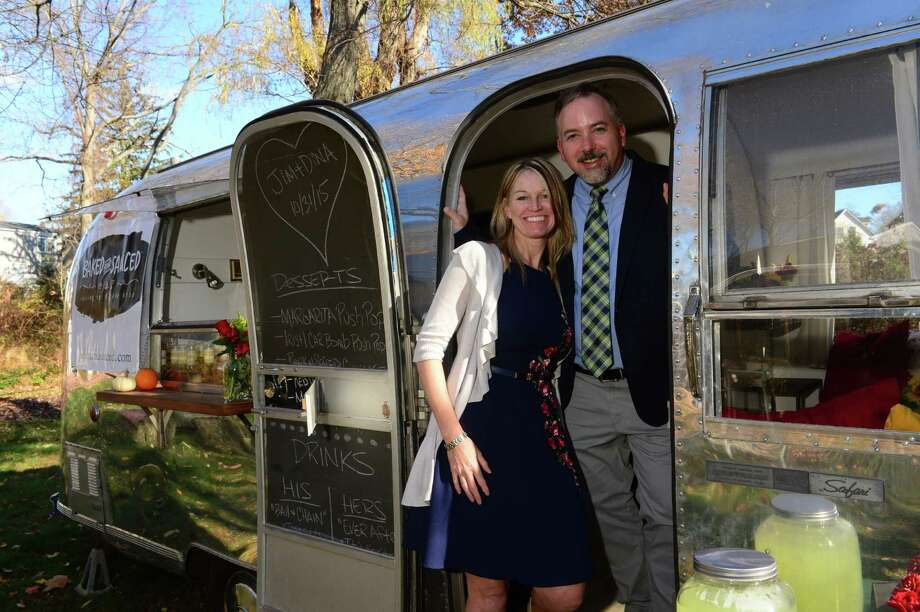 Mike and Kathy McGovern, of Norwalk, in their Airstream turned rolling catering company. Photo: Erik Trautmann / Contributed Photo / ©2015 The Hour Newspapers