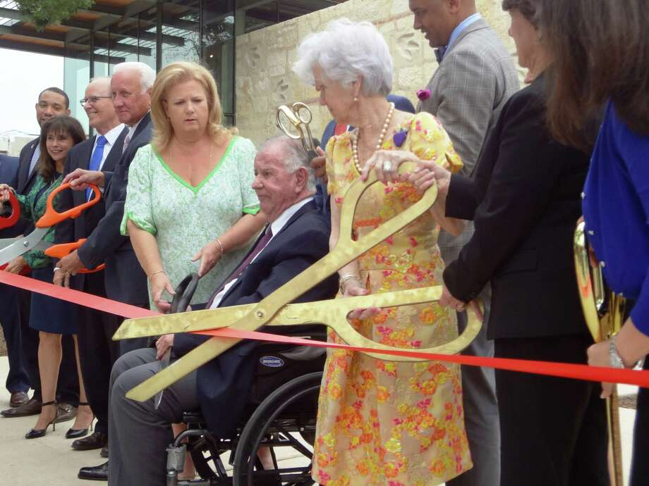 Kathy Mays Johnson (in green dress), her father Lowry Mays and his wife Peggy Mays cut the ribbon on the Mays Family Center at the Witte Museum. The Mays family donated $5 million for the center. Photo: Steve Bennett / San Antonio Express-News