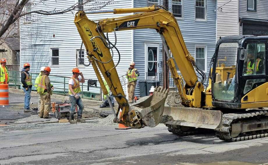 Crews work to repair a water main break at Broadway and John Street Tuesday, April 12, 2016, in Rensselaer, N.Y.  (John Carl D'Annibale / Times Union) Photo: John Carl D'Annibale / 10036160A