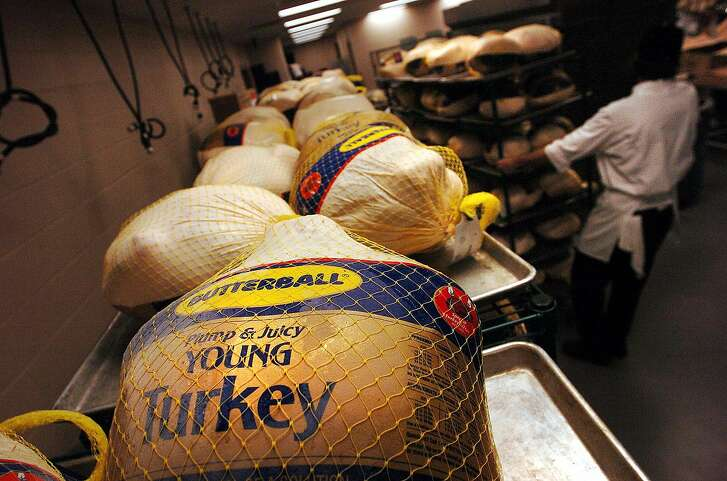 Volunteers unload 400 frozen turkeys for the upcoming Raul Jimenez Thanksgiving dinner at the Convention Center on Sunday, November 21, 2004. This year marks the 25th anniverary of the event which feeds nearly 25,000 people. (Kin Man Hui/staff)