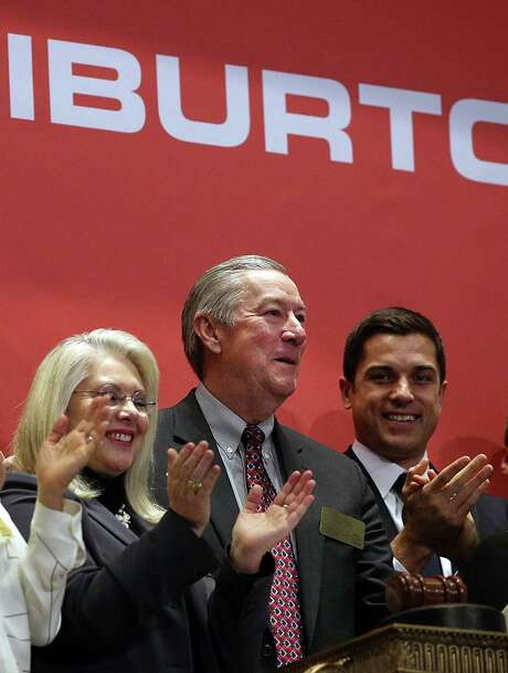 Halliburton CEO David Lesar (center) rings the New York Stock Exchange opening bell on Nov. 18, 2014. The previous day, Halliburton and Baker Hughes announced their plan to combine. Photo: Getty Images File Photo / 2014 Getty Images