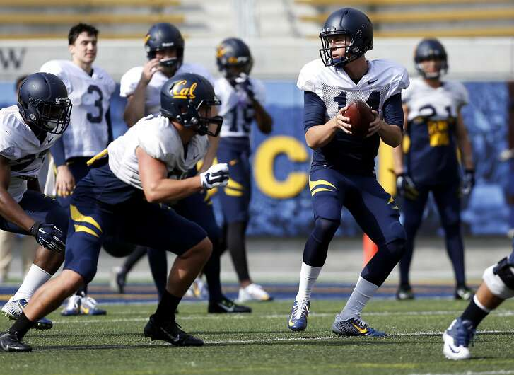 Quarterback Chase Forrest prepares to handoff the ball during a drill at Cal football practice in Berkeley, California, on Monday, April 11, 2016.