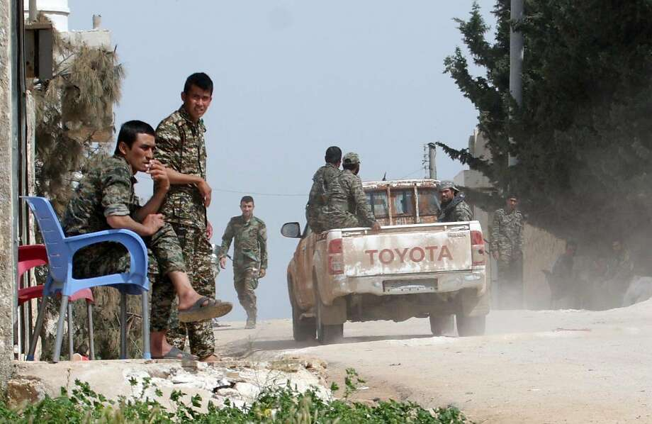 Syrian government forces patrol in the village of Khan Tuman on the southern outskirts of Aleppo. Photo: GEORGE OURFALIAN, AFP/Getty Images