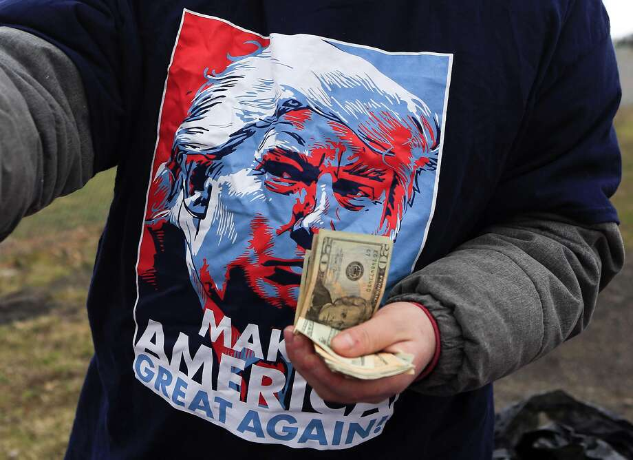 A vendor sells merchandise before a rally for Republican presidential candidate Donald Trump in Rome, N.Y. Photo: Mike Groll, AP