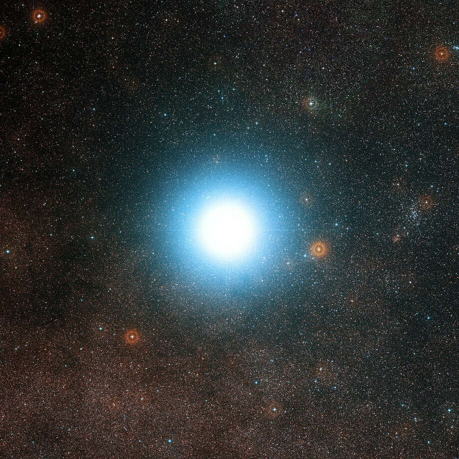 In an undated composite image, Alpha Centauri, the nearest neighboring star system. The Breakthrough Starshot plan, announced on April 12, 2016, proposes to send a fleet of a thousand probes, each no bigger than an iPhone, to Alpha Centauri in about 20 years, to beam information back. Photo: European Southern Observatory /NYT / EUROPEAN SOUTHERN OBSERVATORY