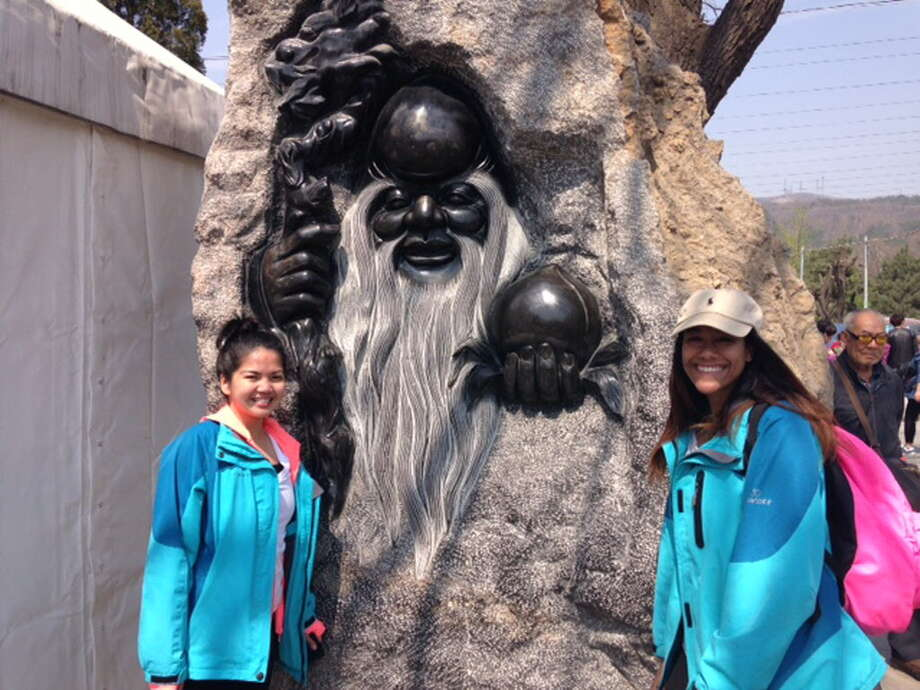 HCC students Alyssa Tejada from Milford and Jannelse Gonzalez, Stratford, are now working at ODIPK in Beijing Photo: Contributed / Contributed