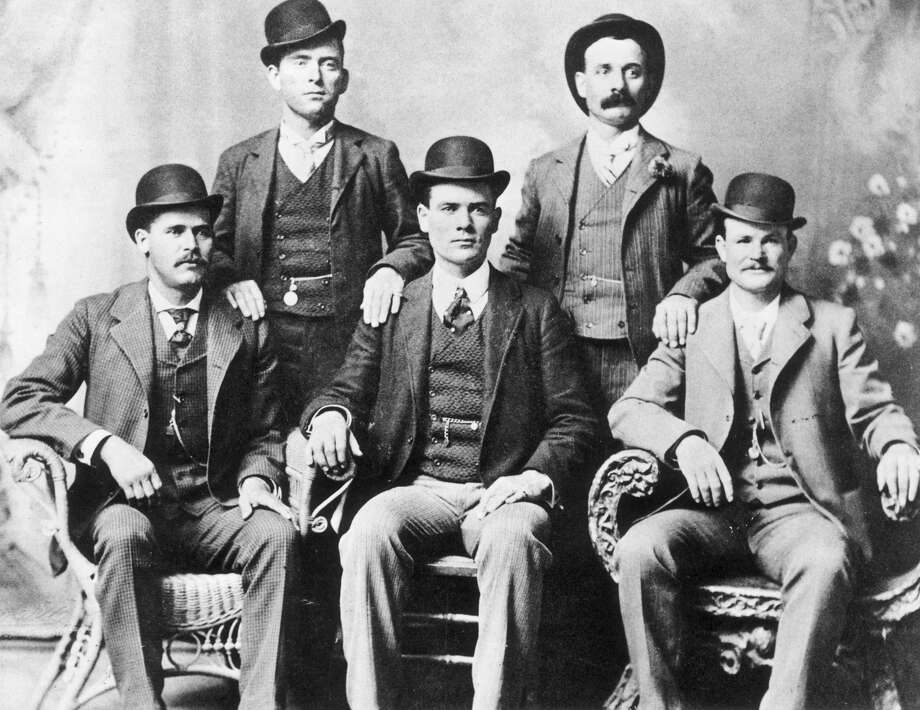 1885:Portrait of the American outlaw gang The Wild Bunch, Texas. From left to right, standing: William Carver, Harvey 'Kid Curry' Logan. Seated: Harry 'Sundance Kid' Langbaugh (1870 - 1909), Ben 'The Tall Texan' Kilpatrick, Robert LeRoy 'Butch Cassidy' Parker (1866 - 1909). Photo: John Swartz, American Stock, Getty Images