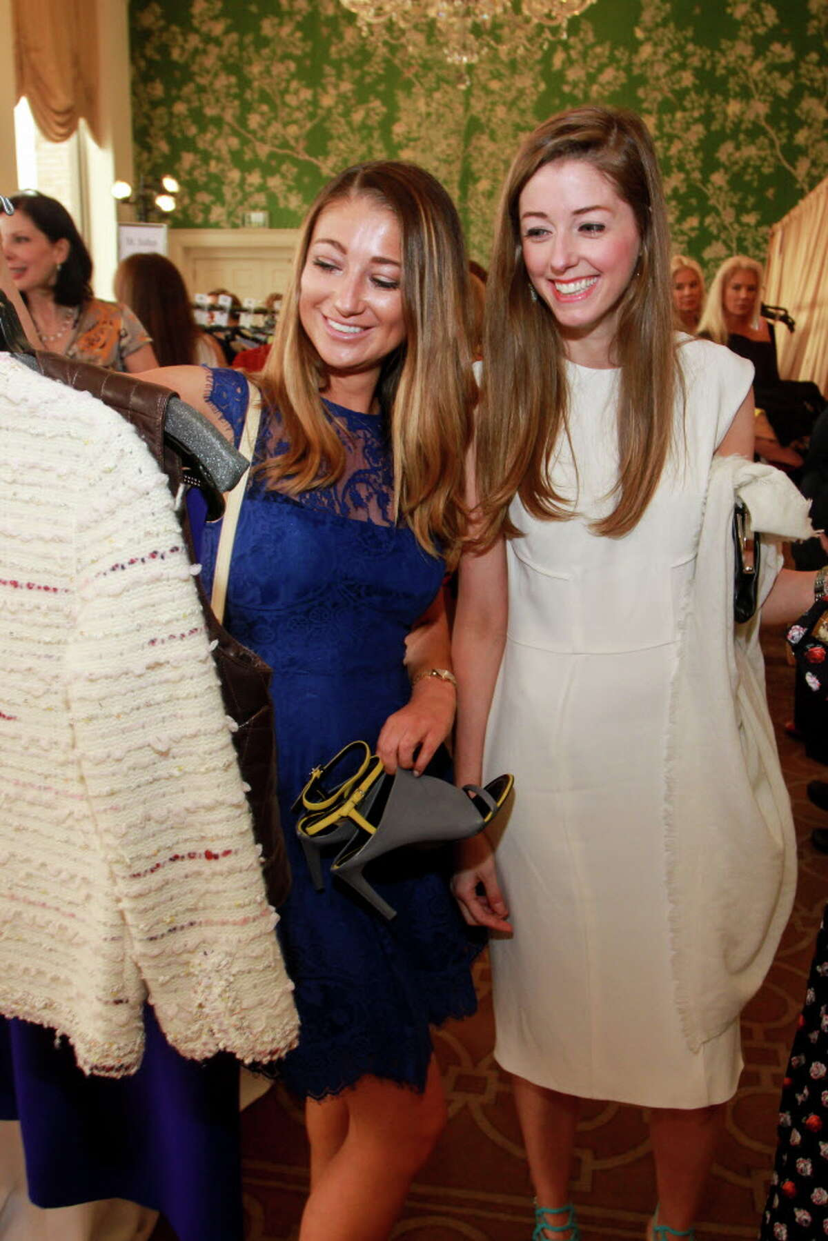 Piper Hatfield, left, and Lauren McEvoy shopping at the annual Chic Boutique and runway fashion show luncheon benefiting the Salvation Army. (For the Chronicle/Gary Fountain, April 12, 2016)