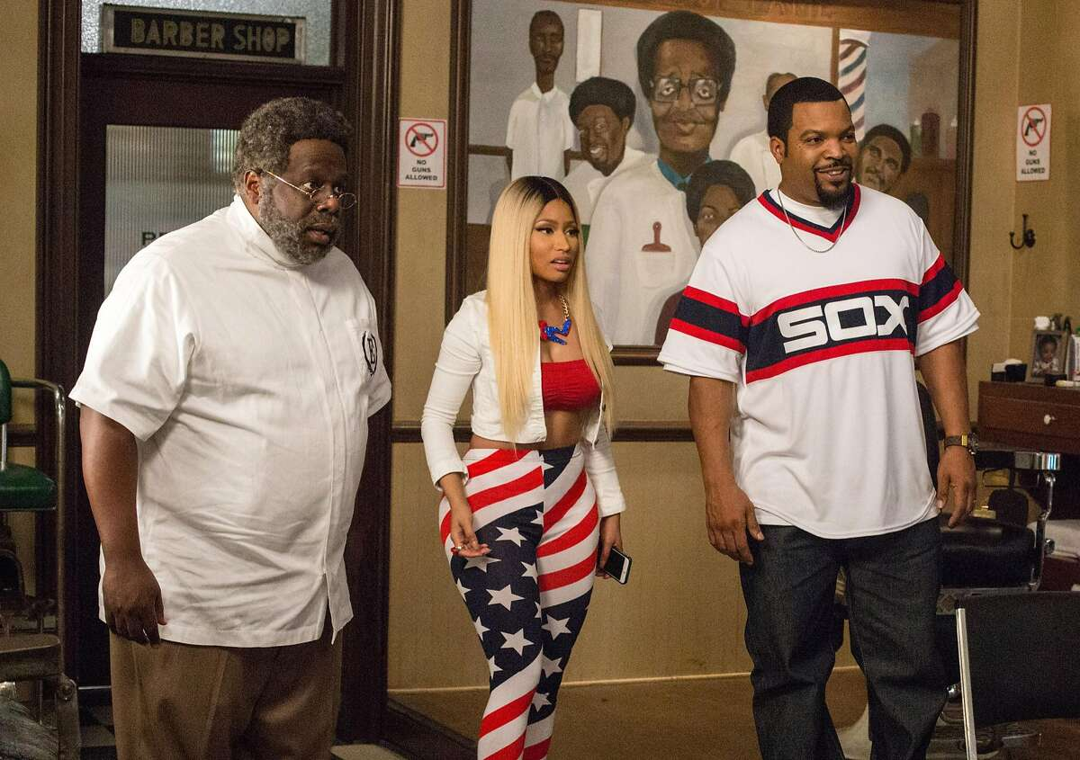 In this image released by Warner Bros., Cedric The Entertainer, from left, Nicki Minaj and Ice Cube appear in a scene from