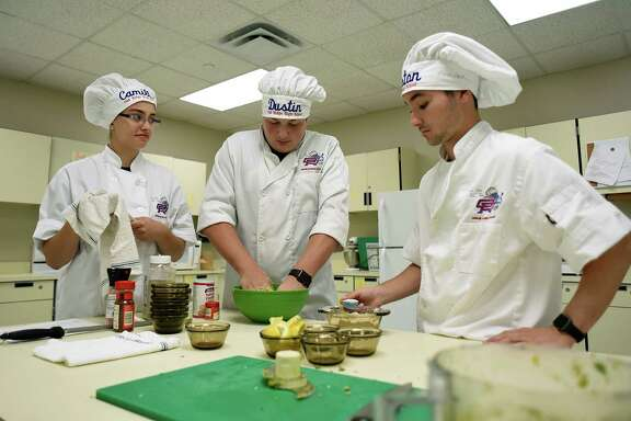 Oak Ridge High School culinary team members Camille Watt, left, Dustin Burkhart and Weston Duke work on their recipe for falafel during a practice session. The students will compete in the Johnson Space Center Food Culinary Challenge on April 21.