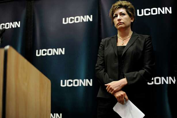 University of Connecticut President Susan Herbst listens to questions from media about the federal civil rights complaint filed by seven women, Oct. 23, 2013, in Storrs, Conn. The women allege they were assaulted while attending UConn and that officials responded with deliberate indifference or worse.