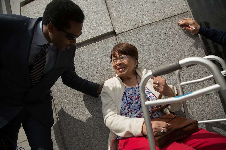 Iris Canada, right, is cheered on by her supporters during a news conference on Tuesday, April 12, 2016 in San Francisco, Calif. Supporters of Canada, a 99-year-old woman who faces eviction from her Western Addition apartment, rallied and held a news conference outside the Superior Court of California. Canada has lived in her apartment for decades. Photo: Santiago Mejia, Special To The Chronicle