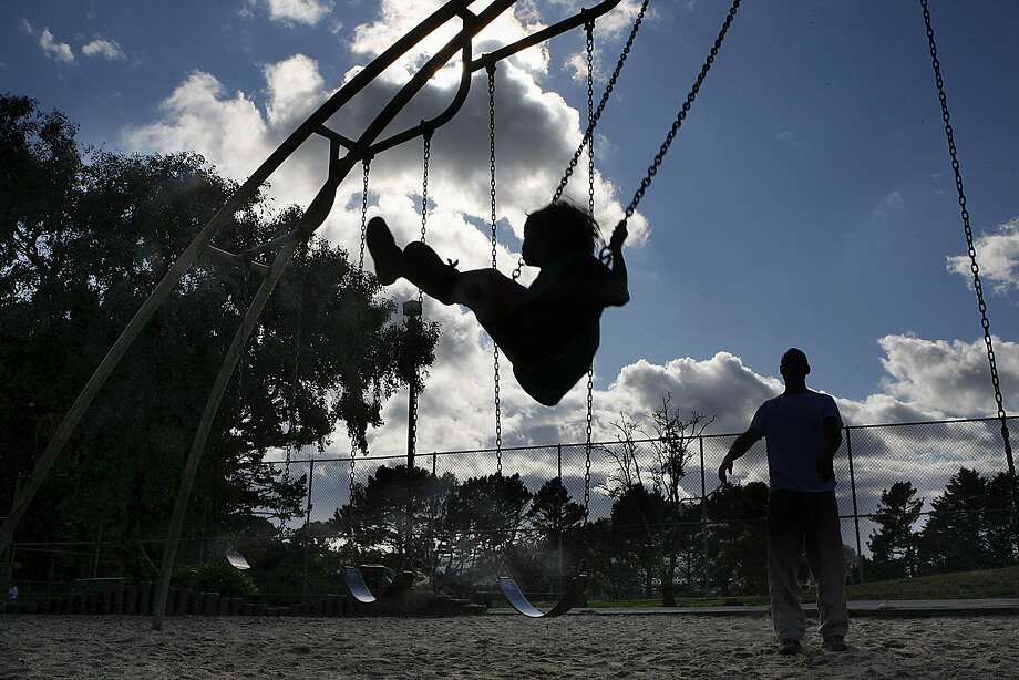 Ruby Zavislak, 4, plays on the swing with her dad, Justin Zavislak, at Christopher Playground on Diamond Heights in San Francisco in 2011. Most contemporary playgrounds are built so safe that it can take the fun out of it for kids. Photo: Liz Hafalia, The Chronicle