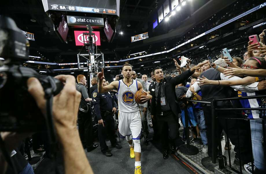 Golden State Warriors' Stephen Curry (30) acknowledges the crowd after they defeated the Spurs at the AT&T Center on Sunday, Apr. 10, 2016. The Warriors defeated the Spurs, 92-86. The Warriors with the victory tied the 1995-96 Chicago Bulls for most wins in an NBA season with 72 victories. (Kin Man Hui/San Antonio Express-News) Photo: Kin Man Hui, San Antonio Express-News