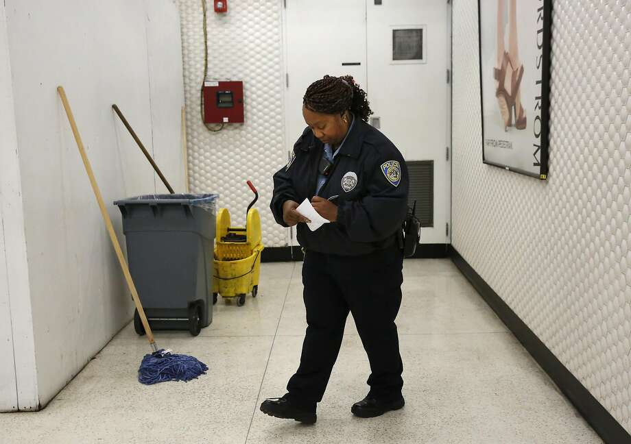 Community Service Officer K. Tate takes down information after checking the light and fire systems as part of her fire patrol in the Powell BART station April 12, 2016 in San Francisco, Calif. Photo: Leah Millis, The Chronicle