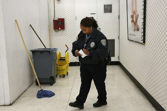 Community Service Officer K. Tate takes down information after checking the light and fire systems as part of her fire patrol in the Powell BART station April 12, 2016 in San Francisco, Calif.