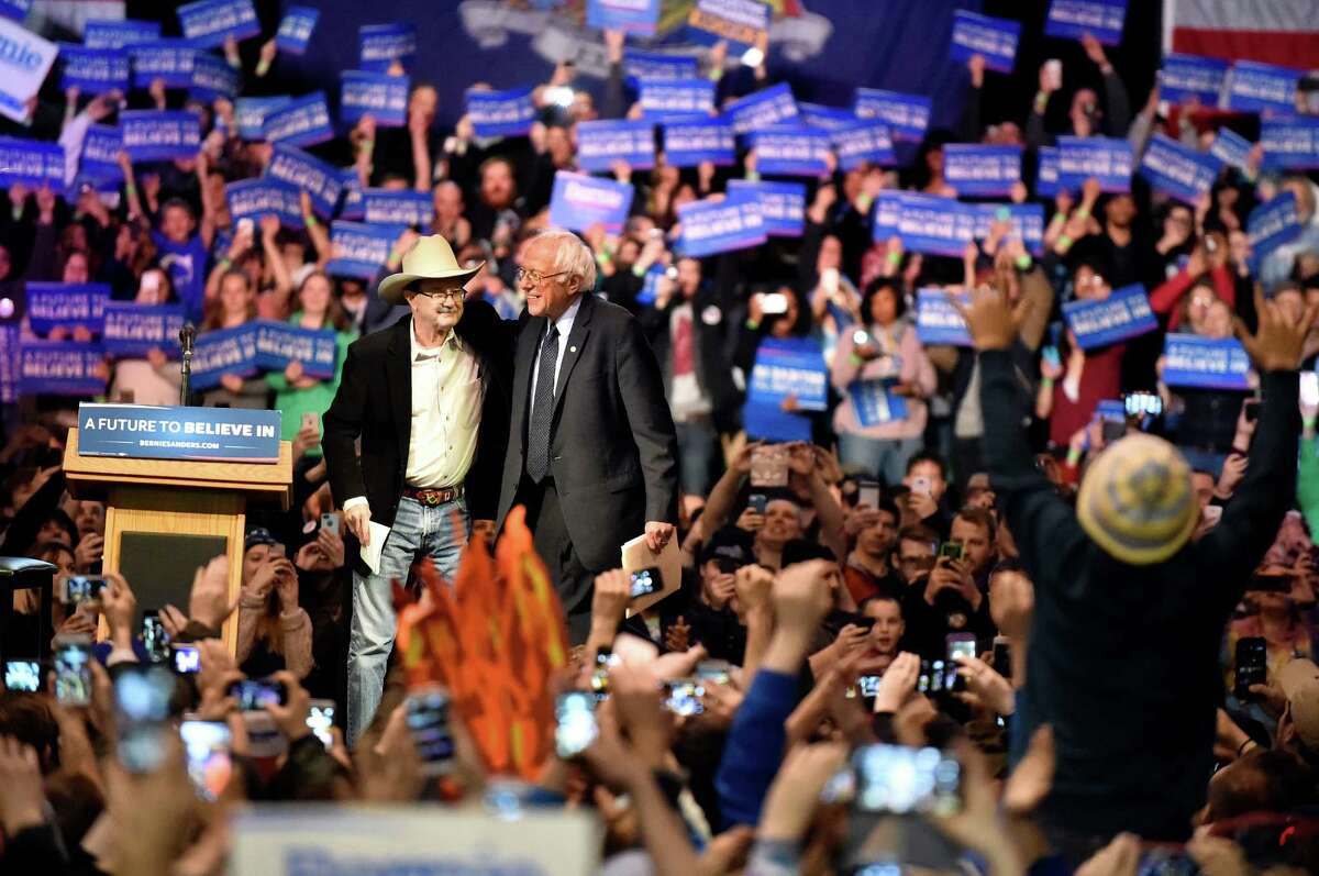 Progressive radio personality Jim Hightower, left, introduces Bernie Sanders, candidate for the Democratic nomination, during a rally on Tuesday, April 11, 2016, at the Washington Avenue Armory in Albany, N.Y. (Cindy Schultz / Times Union)