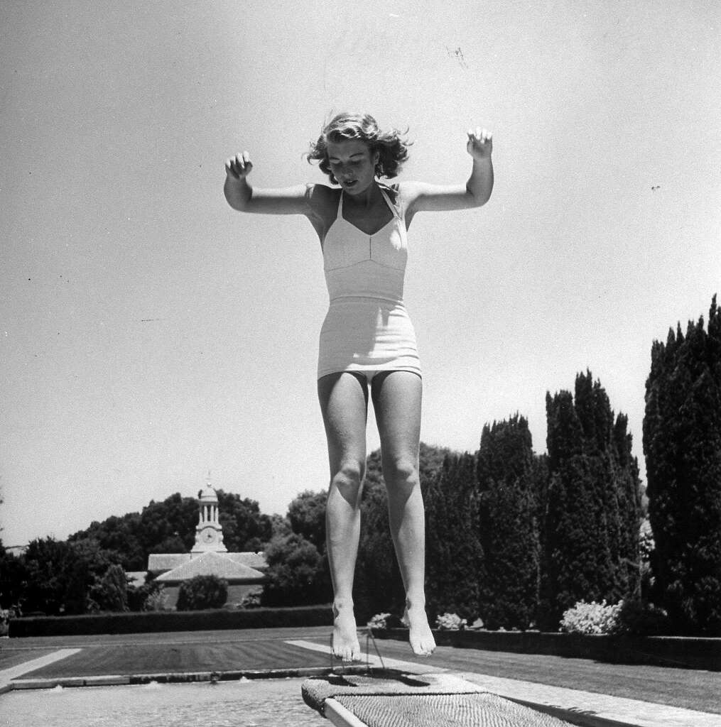 wealth on the peninsula a 1947 life photo essay  simone hotaling bounces on the diving board at the filoli estate pool in woodside california
