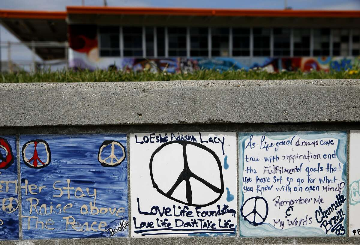 Donald Lacy returns to the Plaza of Peace at McClymonds High School in Oakland, Calif. on Tuesday, April 12, 2016. A tile Lacy made in honor of his daughter is installed in the plaza. LoEshe� Adanma Lacy was a student at McClymonds when she was murdered as a bystander in a shooting across the street from the school in 1997. Following her death, Donald Lacy coined the phrase