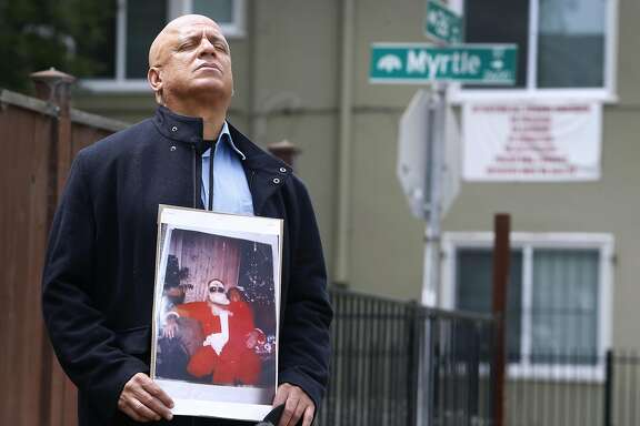 """Donald Lacy returns to the location at 26th and Myrtle streets in Oakland, Calif. on Tuesday, April 12, 2016 where his daughter died 19 years ago. LoEshe� Adanma Lacy was a student at McClymonds High School when she was murdered as a bystander in a shooting across the street from the school in 1997. Following her death, Donald Lacy coined the phrase """"Love Life"""", which Oakland has adopted as a city motto, prompting a bitter fight among city officials."""
