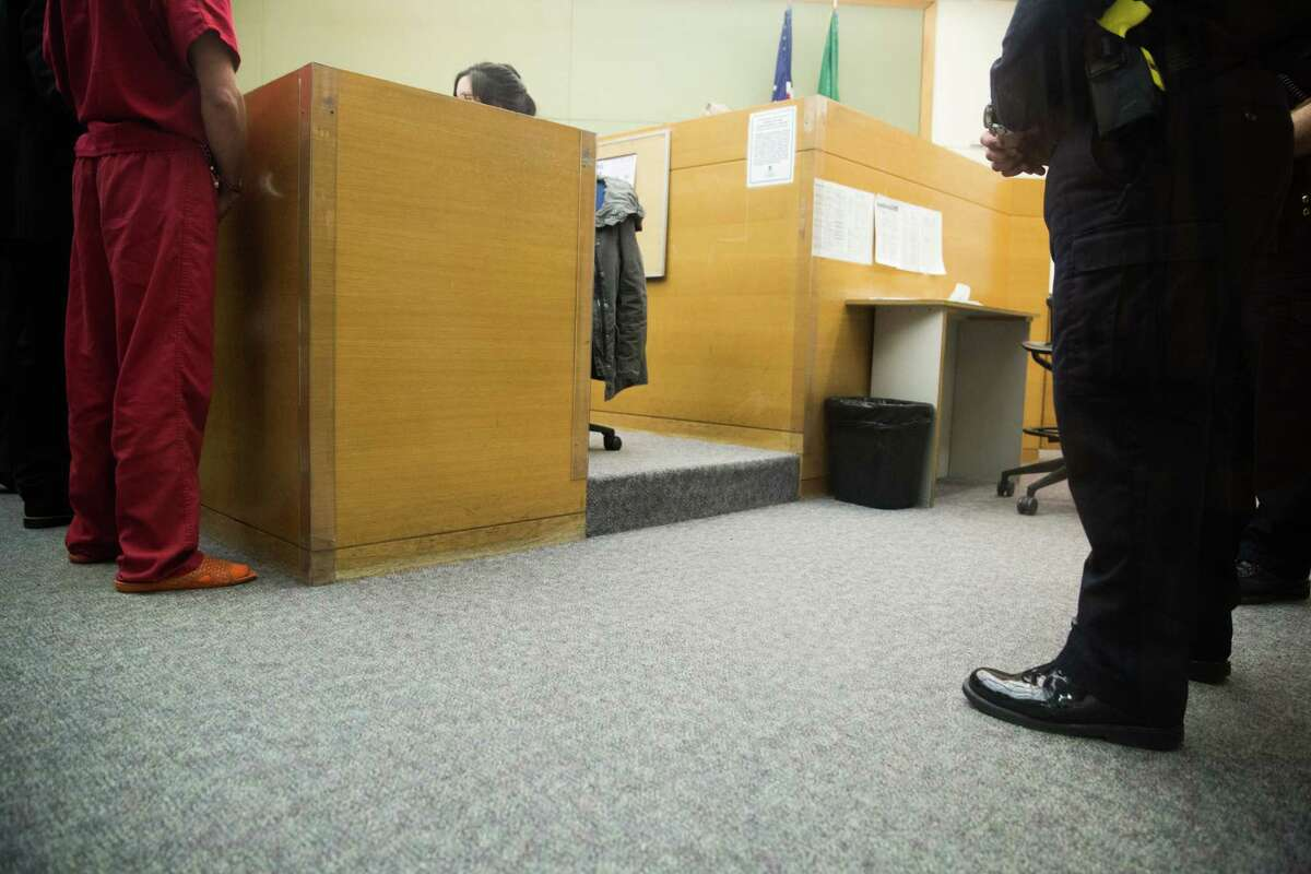 John Robert Charlton appears in court for the first time after being arrested on probable cause for murder in the second degree of Ingrid Lyne of Renton at the King County Jail Courtroom in Seattle on Tuesday, April 11, 2016.