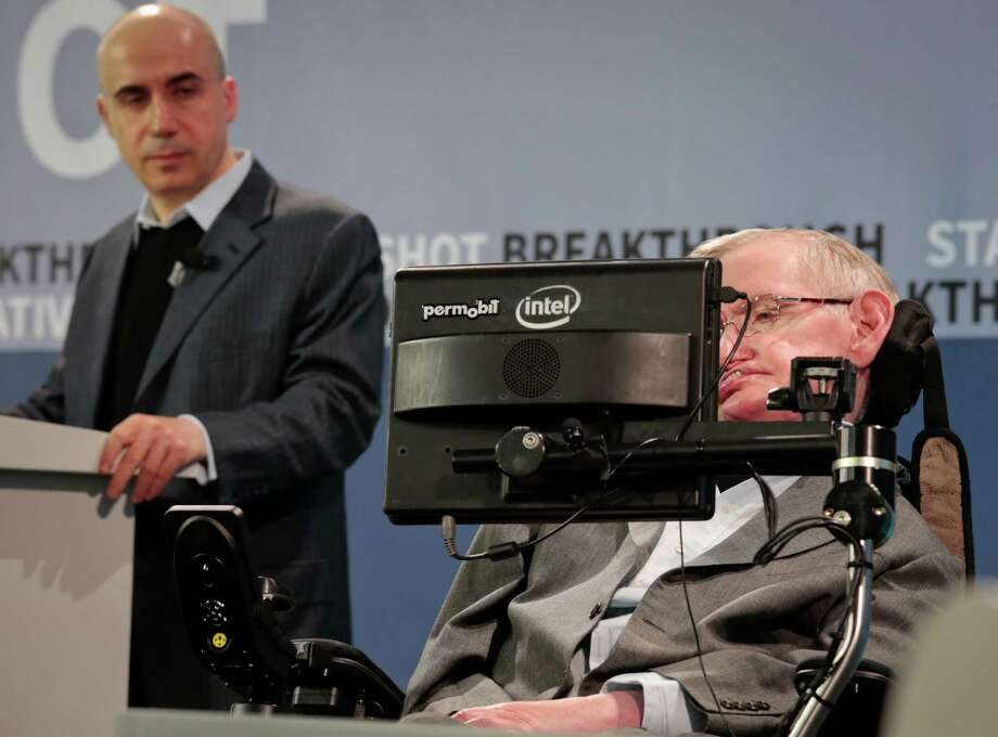Science philanthropist Yuri Milner, left, and cosmologist Stephen Hawking announced $100 million in funding for research into laser-propelled travel, another step in the search for alien life.  Internet investor and science philanthropist Yuri Milner, left, listens as renowned cosmologist Stephen Hawking, right, speaks with the assistance of adaptive speech technology, during a press conference announcing the new Breakthrough Initiative focusing on space exploration and the search for life in the universe, Tuesday April 12, 2016, at One World Observatory in New York. The $100 million project is aimed at establishing the feasibility of sending a swarm of tiny spacecraft, each weighing far less than an ounce, to the Alpha Centauri star system. (AP Photo/Bebeto Matthews) Photo: Bebeto Matthews, STF / Copyright 2016 The Associated Press. All rights reserved. This material may not be published, broadcast, rewritten or redistribu