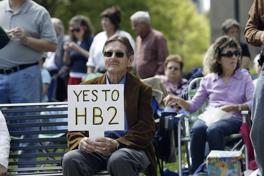 Supporters of House Bill 2 gather at the North Carolina State Capitol in Raleigh on Monday. Photo: Gerry Broome, AP