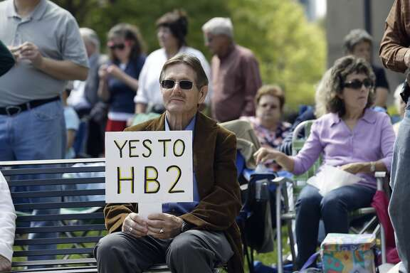 Supporters of House Bill 2 gather at the North Carolina State Capitol in Raleigh, N.C., Monday, April 11, 2016, during a rally in support of a law that blocks rules allowing transgender people to use the bathroom aligned with their gender identity. (AP Photo/Gerry Broome)