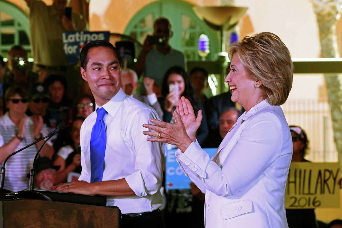 U.S. Secretary of Housing and Urban Development Julian Castro, introduces Democratic presidential candidate Hillary Clinton at a rally at Sunset Station, Thursday, Oct. 15, 2015. The crowd numbered in the thousands and was predominately Hispanic. Before the rally, she attended a Q&A session with members of the U.S. Hispanic Chamber of Commerce.