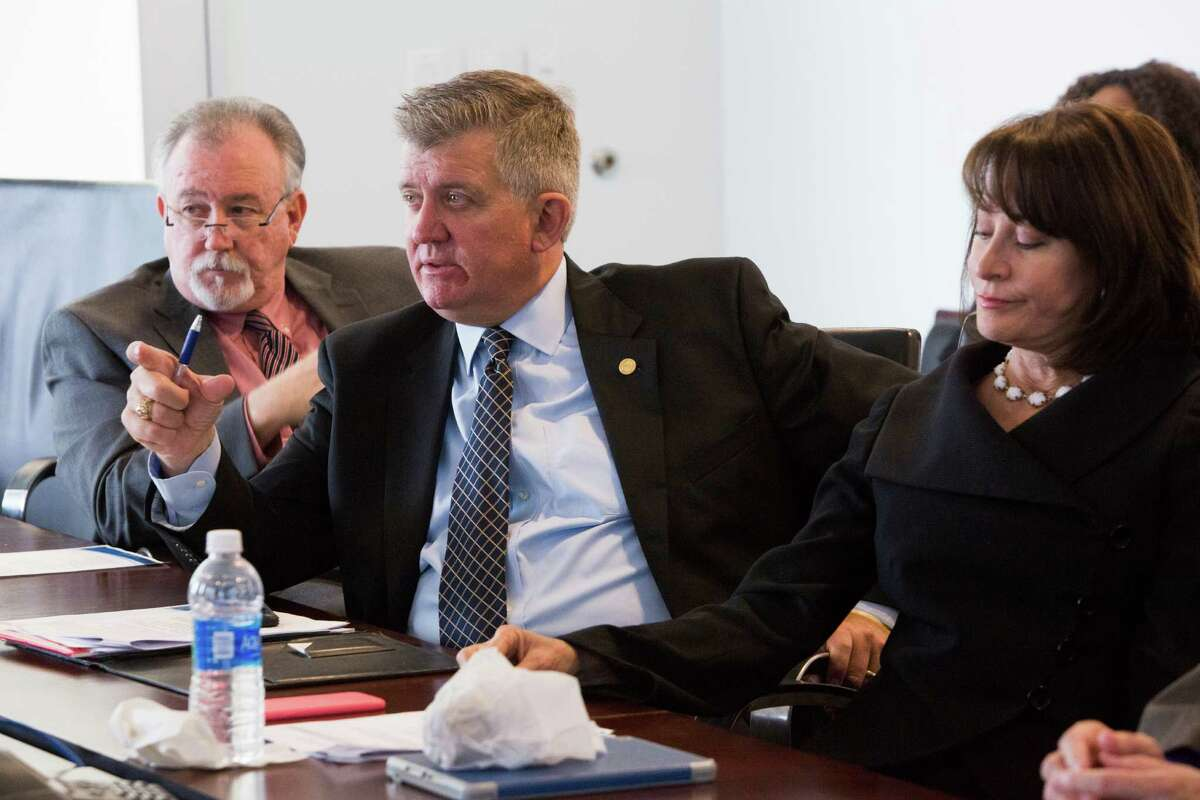 Roger Guenther, center, Port of Houston Executive Director surrounded by the Port Commission Chairman Janiece Longoria, right, and Port Commissioner Stephen DonCarlos, left, speak to the Texas State Senator Brandon Creighton during a meeting at the Port of Houston Authority, Tuesday, April 12, 2016, in Pasadena. ( Marie D. De Jesus / Houston Chronicle )