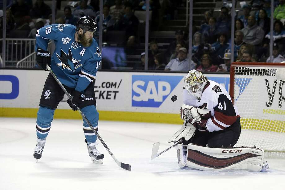 Arizona's Mike Smith stops a shot in front by the Sharks' Joe Thornton in San Jose's regular-season finale Saturday night. The Sharks won that game 1-0. They take on the Kings in Los Angeles to open their playoff series Thursday evening. Photo: Marcio Jose Sanchez, AP
