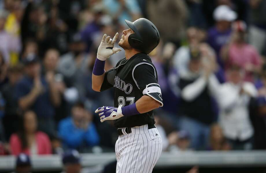 In this April 10, 2016, photo, Colorado Rockies' Trevor Story gestures as he crosses home plate after hitting a solo home run against the San Diego Padres in the eighth inning of a baseball game in Denver.  Photo: David Zalubowski, AP