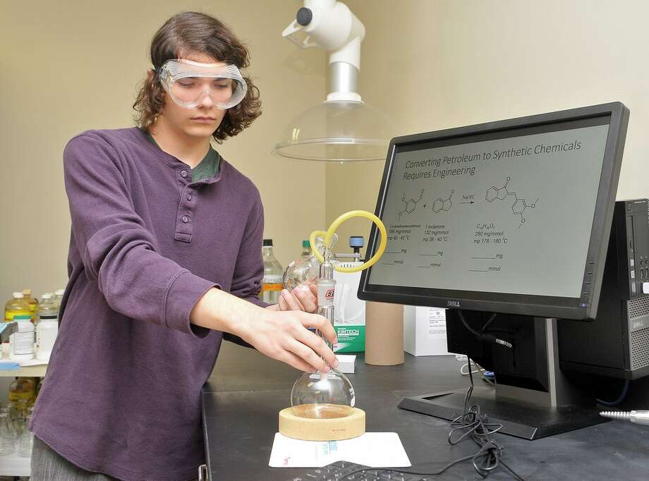 San Jacinto College student Zackary Butterfield sets up for an experiment.