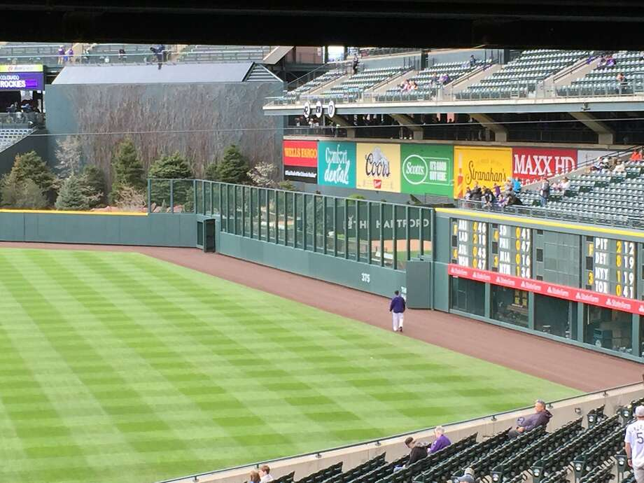 The new fence in right field at Coors Field, which extends to near center field at the same height as the 16-foot, 6-inch scoreboard. Photo: Henry Schulman