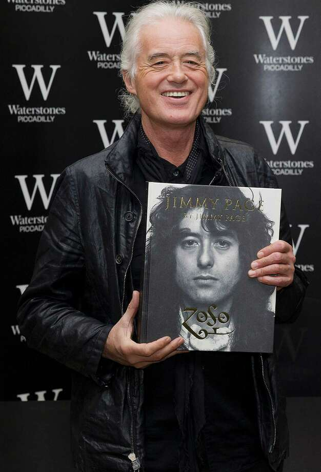 "(FILES) This file photo taken on December 2, 2014 shows British musician Jimmy Page poses for pictures before signing his new book entitled 'Jimmy Page by Jimmy Page' at a Waterstones book shop in central London. A Los Angeles jury will determine whether Led Zeppelin's ""Stairway to Heaven,"" one of the most recognizable songs in rock history, was stolen. A representative of Spirit, a Los Angeles psychedelic band that enjoyed a niche following but never the superstardom of Led Zeppelin, said the song's famous opening melancholy guitar line was lifted from its instrumental track ""Taurus."" After two years of legal proceedings, a judge stopped short of agreeing that the song was copied but said there was enough of a case for a jury trial, which was scheduled for May 10, 2016.  / AFP PHOTO / STRSTR/AFP/Getty Images Photo: STR, Stringer / AFP or licensors"