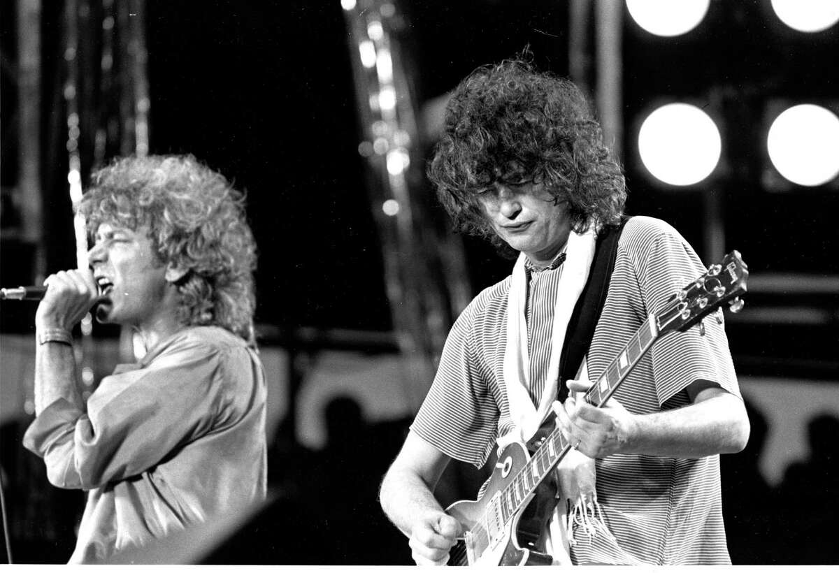 """Robert Plant and Jimmy Page perform in 1985. A judge has ruled that jurors will determine whether """"Stairway to Heaven"""" stole elements from another song."""