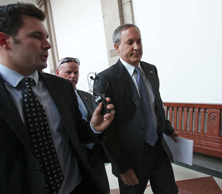 Texas Attorney General Ken Paxton walks the halls of the capitol after he appears before the Senate Health and Human Services Committee on July 29, 2015. Photo: Tom Reel, Staff / San Antonio Express-News / San Antonio Express-News