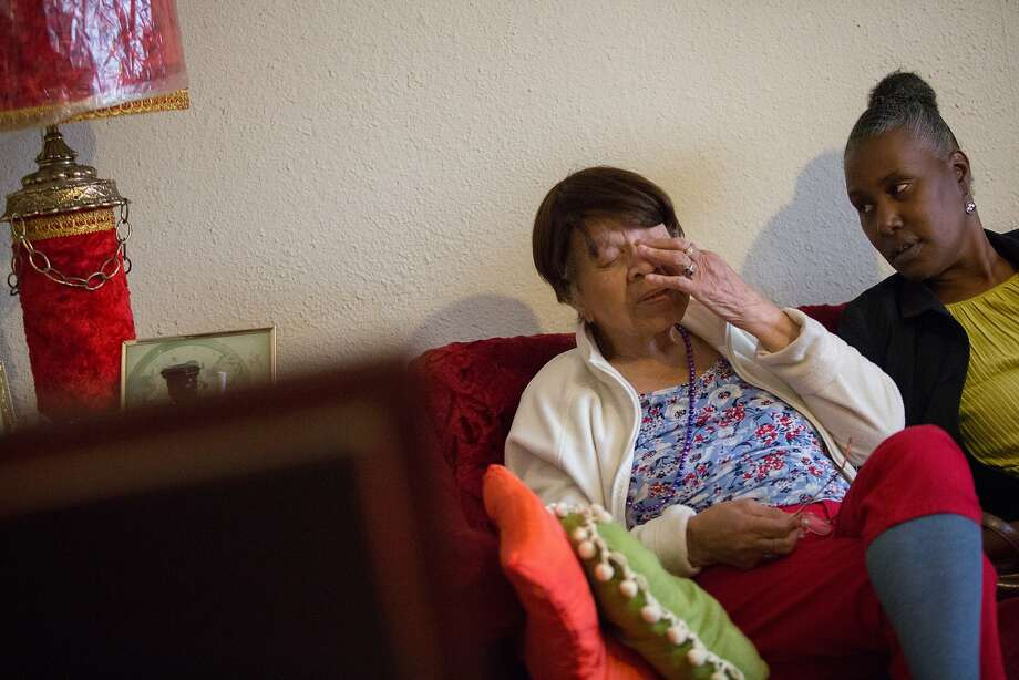 Iris Merriouns, right, checks on her 99-year-old aunt, Iris Canada, on Tuesday, April 12, 2016 in San Francisco, Calif. Canadadied Saturday night after suffering a stroke after her eviction. Photo: Santiago Mejia, Special To The Chronicle
