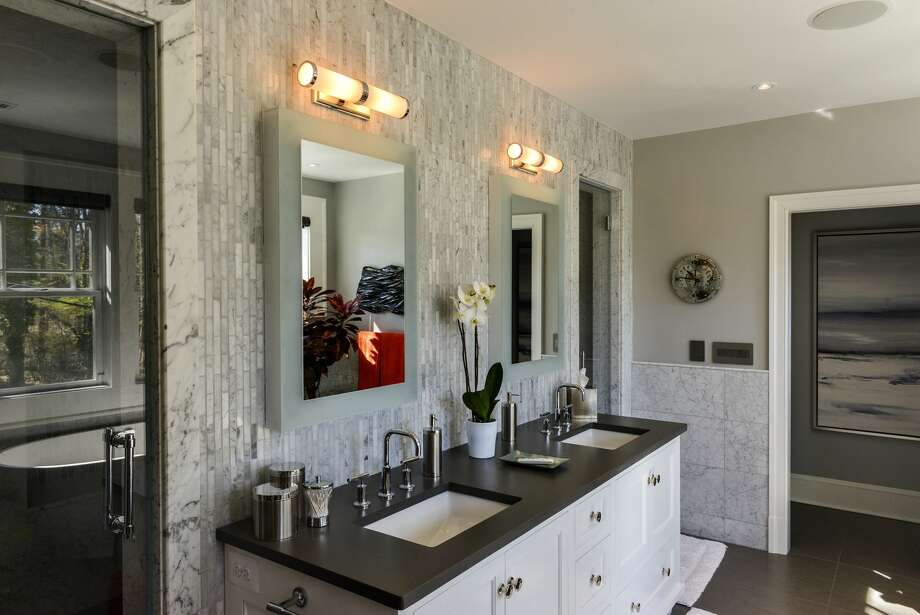 A remodeling project at the McLean, Va., home of Jay Timmons and Rick Olson was supposed to take one year. Instead, it took nearly three years and cost 70 percent more than the original contract price; here, a renovated bathroom. Photo: Bill O'Leary, Washington Post