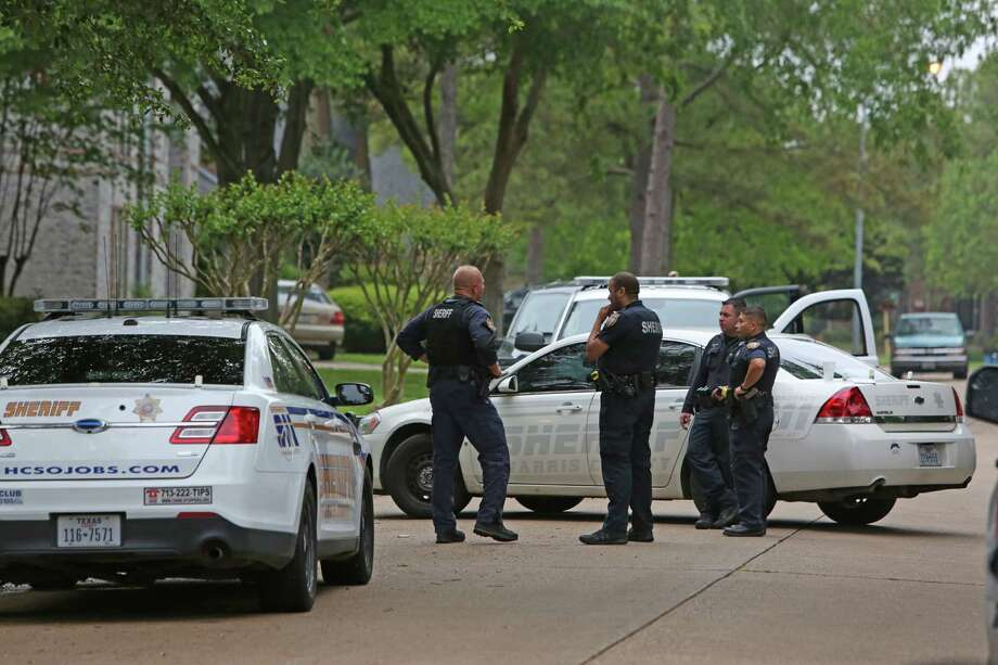 The Harris County Sheriff's Office aided the Bureau of Alcohol, Tobacco, Firearms and Explosives as they served a warrant Tuesday at a house in northwest Harris County. Three people, including a man and his son, are accused of selling and conspiring to sell crystal methamphetamine and laundering the proceeds.  Photo: Steve Gonzales / © 2016 Houston Chronicle