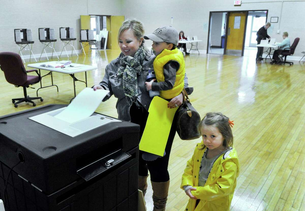 Carrie Sirois, with her kids Grayson, 2, and Reese, 4, votes in Tuesday's budget referendum in Bethel, April 12, 2016, at the Municipal Center polling place.