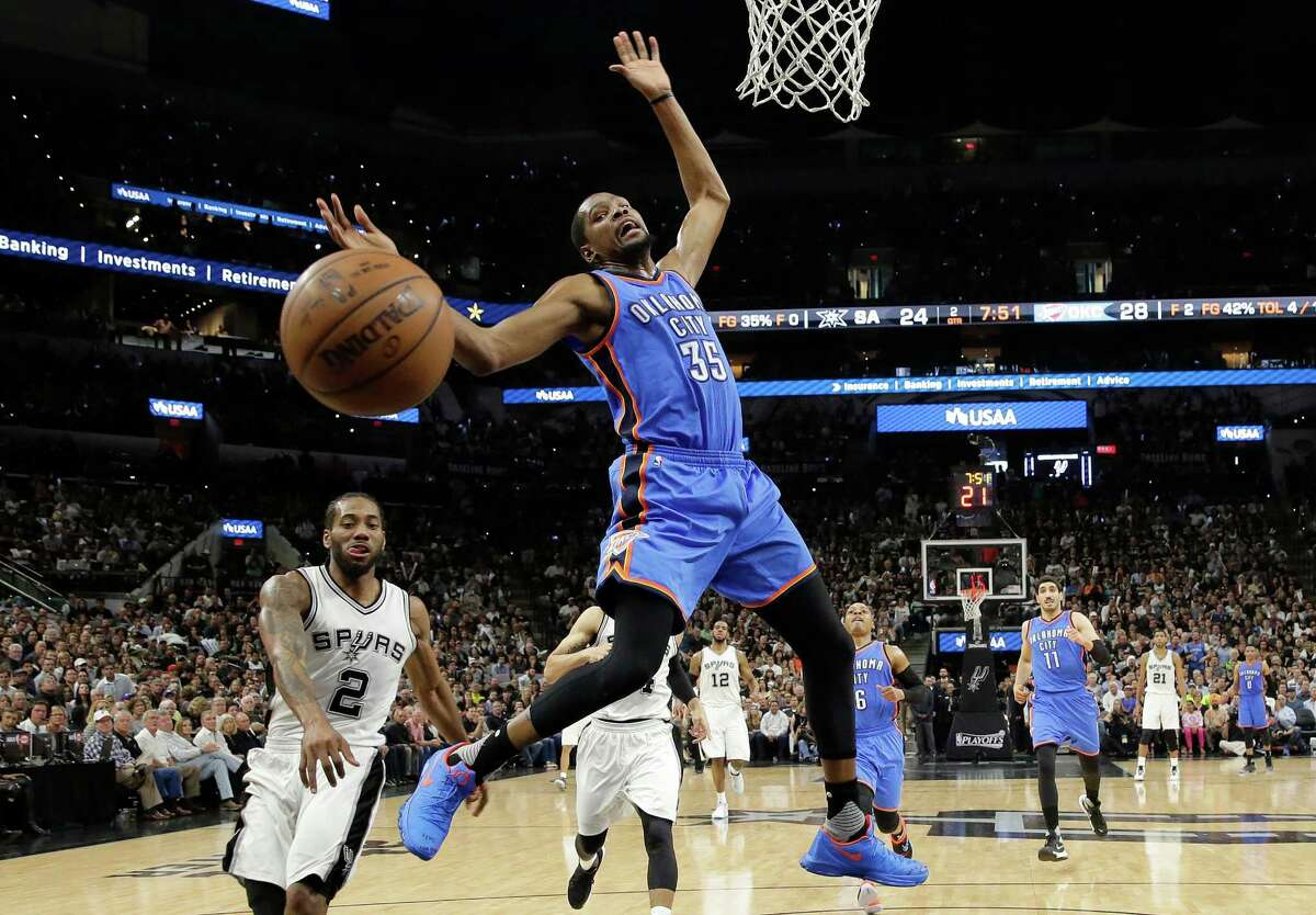 Oklahoma City Thunder forward Kevin Durant (35) is fouled by San Antonio Spurs forward Kawhi Leonard (2) as he drives to the basket during the first half in Game 5 of a second-round NBA basketball playoff series, Tuesday, May 10, 2016, in San Antonio. (AP Photo/Eric Gay)