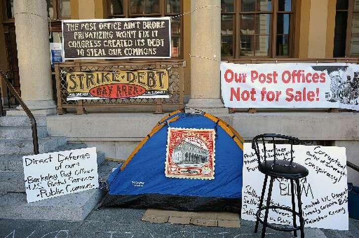 This 2013 photo shows protesters' tents outside Berkeley's main post office on Allston Way after the historic building was poised to be closed. The building is no longer in danger of being sold but others unaffiliated with the initial protest have stayed in tents outside the area. Postal service police cleared the small homeless camp early Tuesday morning.