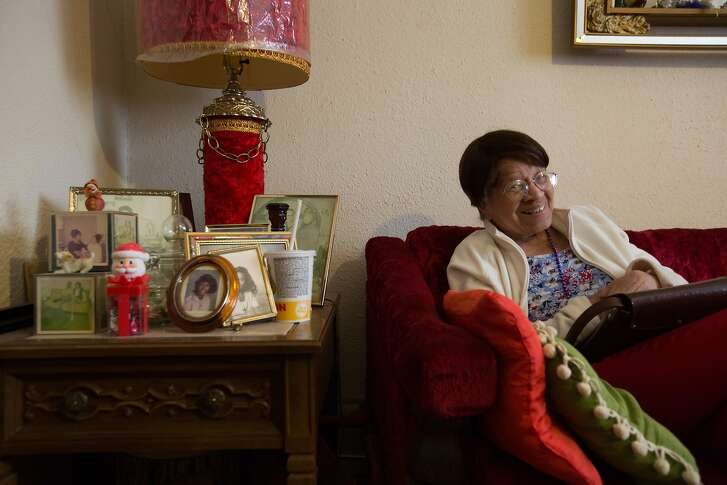 99-year-old Iris Canada laughs as she sees herself on television, Tuesday, April 12, 2016 in San Francisco, Calif. Canada faces eviction from her Western Addition apartment, where she has lived since the 1940s.