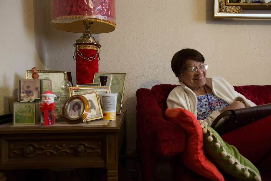 The late Iris Canada laughs as she sees herself on television in 2016 when she was facing eviction from her Page Street apartment. Photo: Santiago Mejia, Special To The Chronicle