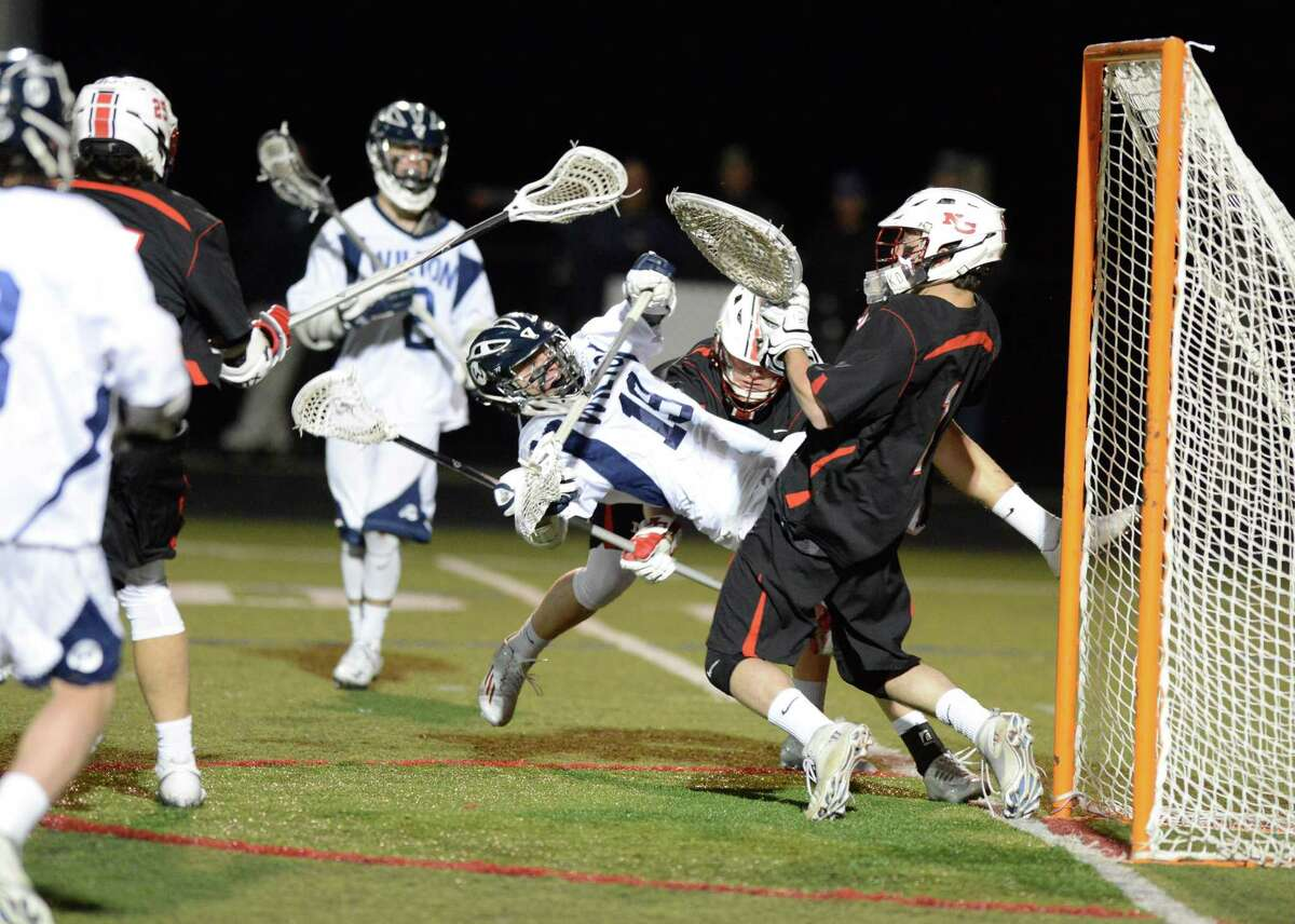 Wilton Harley Jeanty (18) takes a shot on New Canaan goalie Drew Morris in a boys lacrosse game in Wilton on April 12, 2016. New Canaan defeated Wilton 11-2.