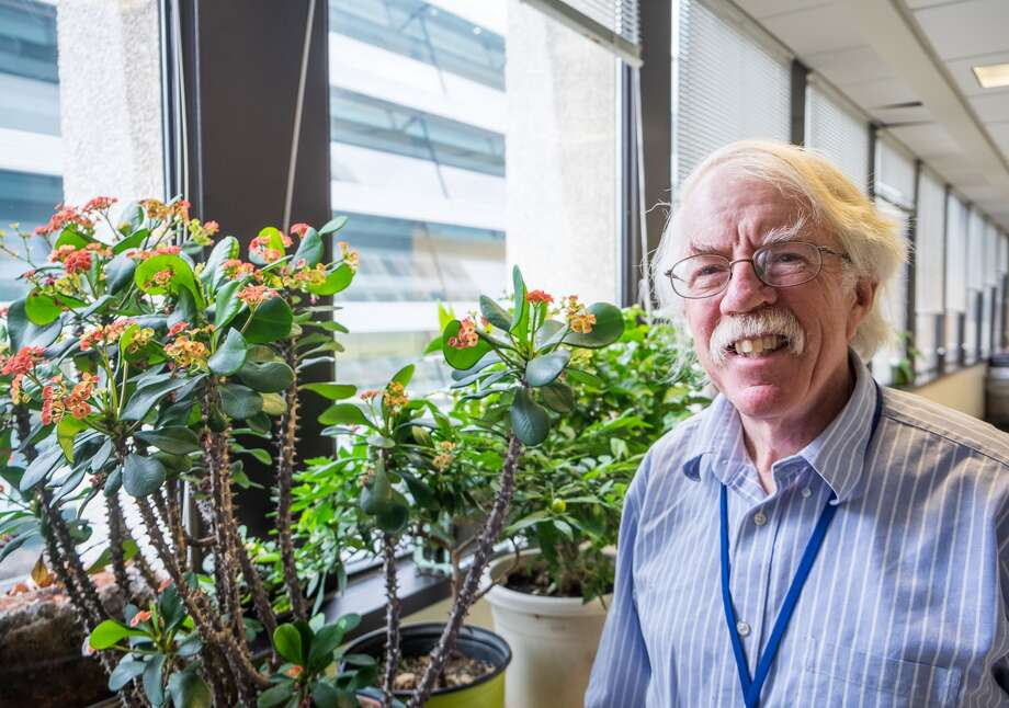 Peter Blumberg, a cancer researcher at the National Cancer Institute in Bethesda, Md., stands next to a crown of thorns plant, which is in the family of plants he studied. That research led to hot pepper bird seed, designed to thwart squirrels. Photo: John Kelly, Washington Post