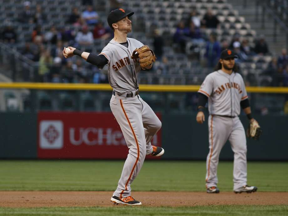 Matt Duffy throws out the Rockies' Trevor Story on a slow first-inning groundball. Photo: David Zalubowski, AP