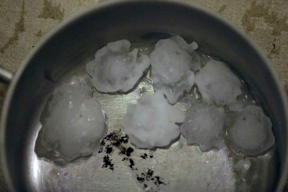 Golf ball-sized hail that fell about 10 p.m. Tuesday night in the San Antonio area. USAA received about 11,000 auto claims and 5,500 property claims as of about 11 a.m. Wednesday morning, but the company expects those numbers will climb. Photo: William Luther /San Antonio Express-News / © 2016 San Antonio Express-News